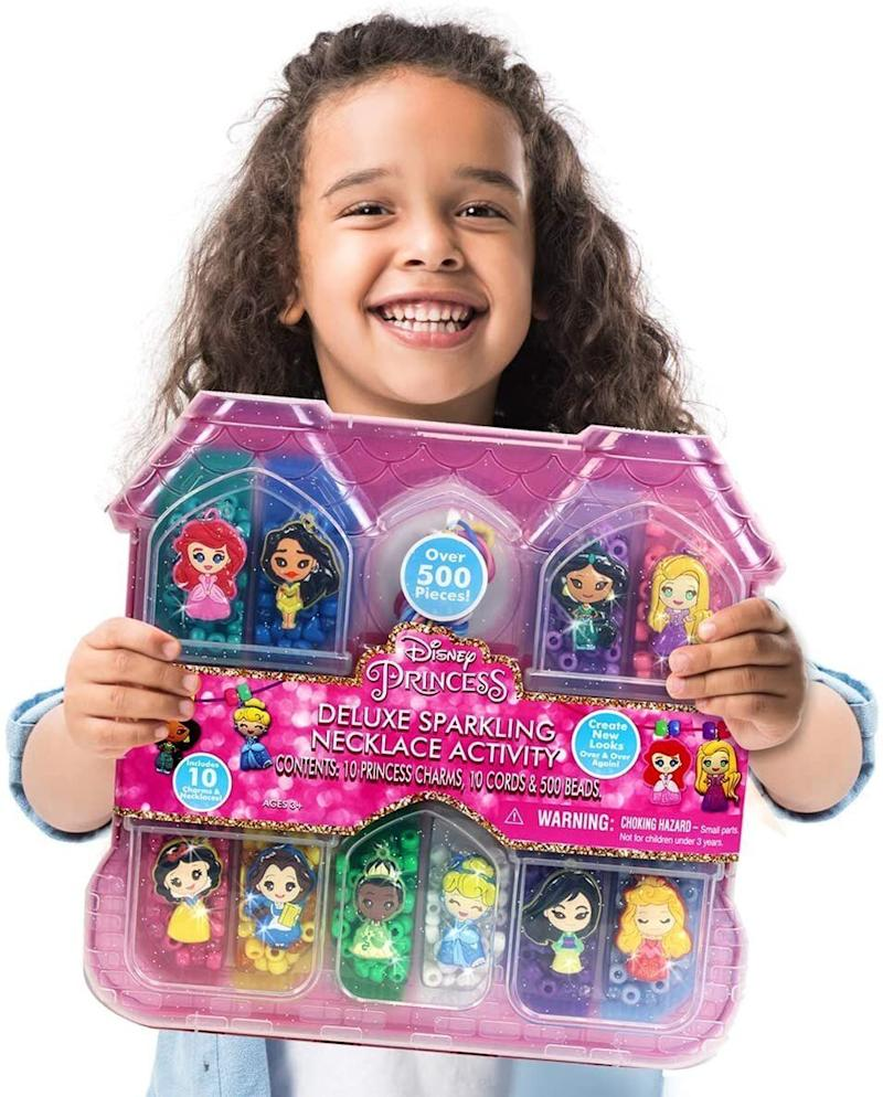 """Kiddos can <a href=""""https://amzn.to/2Hmbb5x"""" target=""""_blank"""" rel=""""noopener noreferrer"""">make their own jewelry</a> with this activity set, which includesbeads, closures andcharacter charms. It has over 500 pieces to make 10 different necklaces. They can have one-of-kind necklaces that they made all by themselves. <a href=""""https://amzn.to/2Hmbb5x"""" target=""""_blank"""" rel=""""noopener noreferrer"""">Find it for $20 at Amazon</a>."""