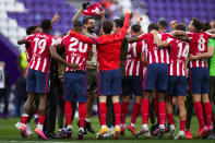 Atletico Madrid players jubilate at the end of the Spanish La Liga soccer match between Atletico Madrid and Valladolid at the Jose Zorrilla stadium in Valladolid, Spain, Saturday, May 22, 2021. Atletico won 2-1 and clinches its 11th Spanish La Liga title. (AP Photo/Manu Fernandez)