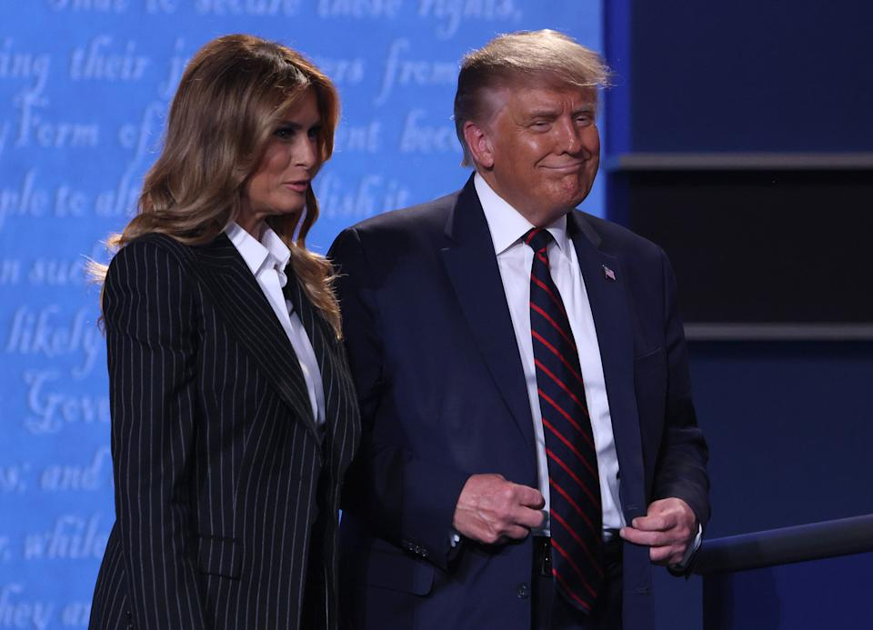CLEVELAND, OHIO - SEPTEMBER 29:  U.S. President Donald Trump and first lady Melania Trump smile on stage after the first presidential debate between Trump and Democratic presidential nominee Joe Biden at the Health Education Campus of Case Western Reserve University on September 29, 2020 in Cleveland, Ohio. This is the first of three planned debates between the two candidates in the lead up to the election on November 3. (Photo by Scott Olson/Getty Images)