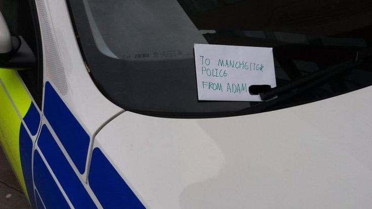Adorable: A boy - called Adam - left a thank you note on a police van to say thanks for keeping the community safe. (Greater Manchester Police)