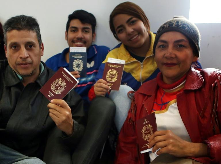 Venezuelan migrants wait to board a free flight home at Lima's international airport after experiencing difficulties in Peru on August 27, 2018