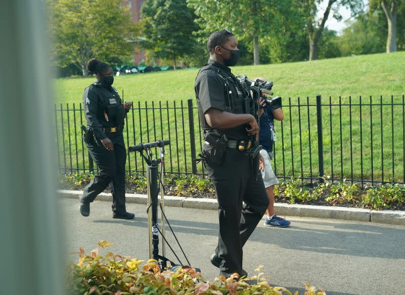 Members of U.S. Secret Services patrol the White House in Washington