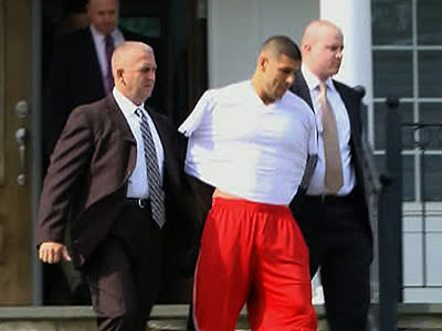 New England Patriots tight end Aaron Hernandez was taken from his home in handcuffs Wednesday, more than a week after a Boston semi-pro football player was found dead in an industrial park a mile from the player's house. (June 26)