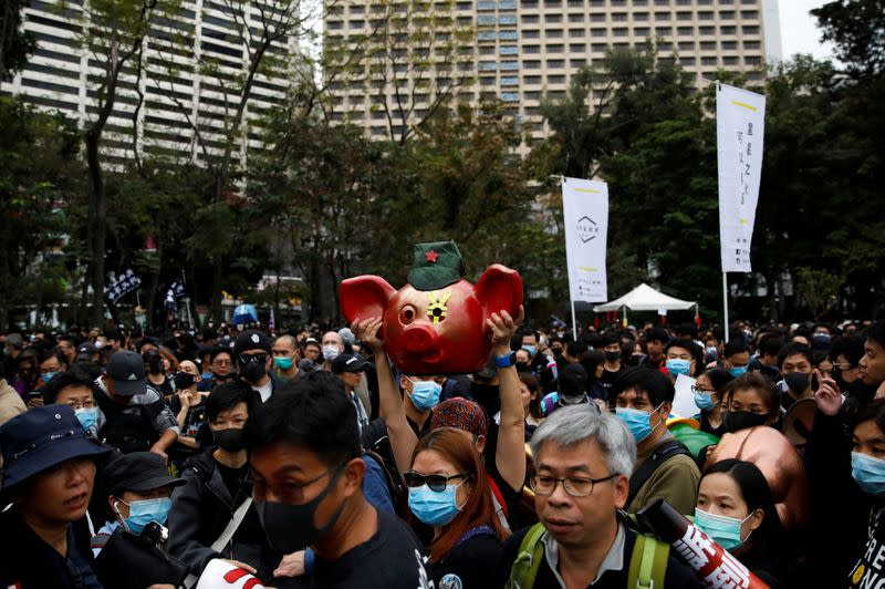 Hong Kong police fire tear gas during mass New Year's day march
