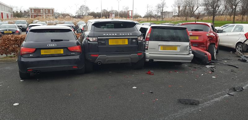 """PIC BY MERCURY PRESS (PICTURED the trail of destruction left by a Range Rover after it drove into 4 parked cars at a gym in Garston, Liverpool) Must've been leg day! Gymgoers were shocked after a bungling female driver in a Range Rover destroyed four parked cars – before driving off. These dramatic scenes show the aftermath at 24/7 Fitness in Garston, Liverpool, this morning [THURS] after four cars were totalled by the clumsy motorist, believed to be in her early to mid-twenties. An eyewitness, who asked not to be named, spotted the carnage after finishing her workout. The woman said: """"I walked out of the gym and heard a car alarm going off. SEE MERCURY COPY"""