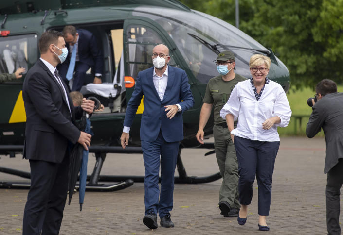 European Council President Charles Michel, left, and Lithuania's Prime Minister Ingrida Simonyte arrive at the Border Guard School near Lithuanian-Belarusian border, near the village Medininkai, some 25 km (24 miles) east of the capital Vilnius, Lithuania, Tuesday, July 6, 2021. (AP Photo/Mindaugas Kulbis)