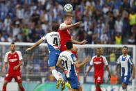 Sevilla's Luuk de Jong, top, jumps for the ball with Espanyol's Victor Sanchez during the Spanish La Liga soccer match between Espanyol and Sevilla at the RCDE Stadium in Barcelona, Spain, Sunday Aug.18, 2019. (AP Photo/Joan Monfort)