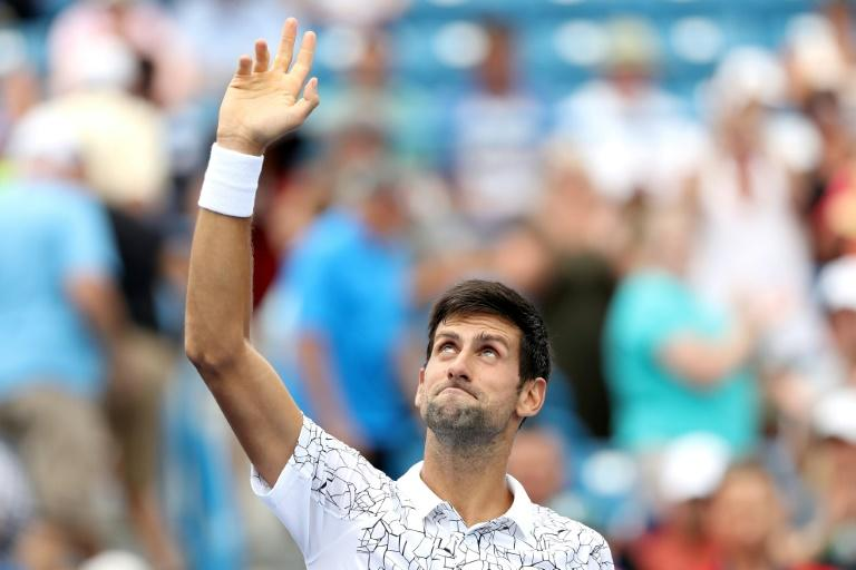 Things are looking up: Novak Djokovic celebrates his win over Grigor Dimitrov