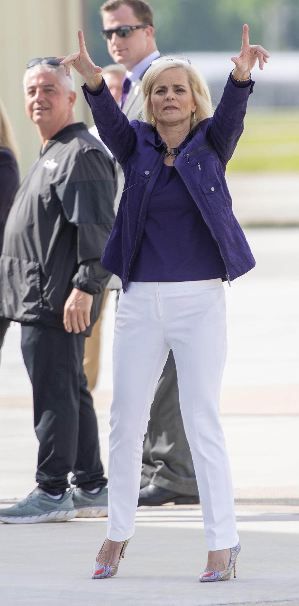 Former Baylor women's basketball coach Kim Mulkey waves the folks behind the fence after arriving at Metro Airport to become LSU's women's basketball coach Monday, April 26, 2021, in Baton Rouge, La. (Bill Feig/The Advocate via AP)