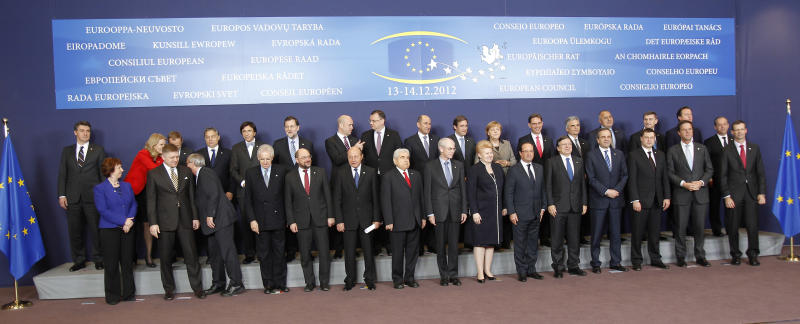 EU heads of state pose for the media, at the start of a two-day EU summit, at the European Council building in Brussels, Thursday, Dec. 13, 2012. In one whirlwind morning, the European Union nations agreed on the foundation of a fully-fledged banking union and Greece's euro partners approved billions of euros in bailout loans that will prevent the nation from going bankrupt. First row from left to right: EU foreign policy chief Catherine Ashton, Slovakia's Prime Minister Robert Fico, Luxembourg's Prime Minister Jean-Claude Juncker, Italy's Prime Minister Mario Monti, European Parliament President Martin Schulz, Romania's President Traian Basescu, Cypriot President Dimitris Christofias, European Council President Herman Van Rompuy, Lithuania's President Dalia Grybauskaite, French President Francois Hollande, European Commission President Jose Manuel Barroso, Greek Prime Minister Antonis Samaras, Latvian Prime Minister Valdis Dombrovskis, Dutch Prime Minister Mark Rutte, and the Secretary-General of the EU Council Uwe Corsepius. Top row: Croatia's Prime Minister Zoran Milanovic, Denmark's Prime Minister Helle Thorning-Schmidt, Poland's Prime Minister Donald Tusk, Hungarian Prime Minister Viktor Orban, Belgium's Prime Minister Elio Di Rupo, Spain's Prime Minister Mariano Rajoy, Swedish Prime Minister Fredrik Reinfeldt, Czech Republic's Prime Minister Petr Necas, Slovenia's Prime Minister Janez Jansa, Portugal's Prime Minister Pedro Passos Coelho, German Chancellor Angela Merkel, Finland's Prime Minister Jyrki Katainen, Austrian Chancellor Werner Faymann, Bulgarian Prime Minister Boyko Borissov, Estonia's Prime Minister Andrus Ansip, British Prime Minister David Cameron, and Malta's Prime Minister Lawrence Gonzi. (AP Photo/Michel Euler)
