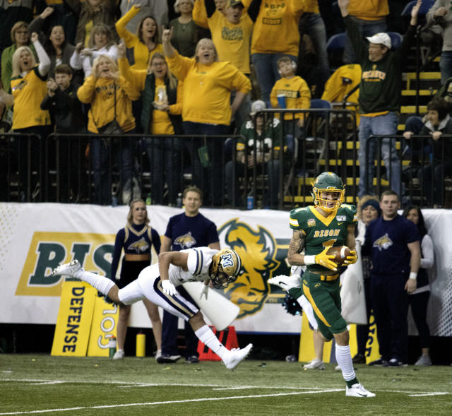 North Dakota State wide receiver Christian Watson (1) scores in the first half of an FCS playoff NCAA college football game against Montana State, Saturday, Dec. 21, 2019, in Fargo, N.D. (AP Photo/Bruce Crummy)