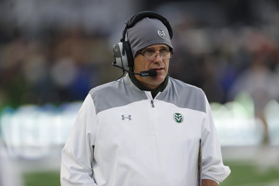 In this Friday, Nov. 29, 2019, photograph, Colorado State head coach Mike Bobo walks the sidelines in the second half of an NCAA college football game against Boise State in Fort Collins, Colo. Boise State won 31-24. Bobo was relieved of his duties Wednesday, Dec. 4, 2019, after five years on the job. (AP Photo/David Zalubowski)