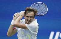 Daniil Medvedev, of Russia, returns a shot to Rafael Nadal, of Spain, during the men's singles final of the U.S. Open tennis championships Sunday, Sept. 8, 2019, in New York. (AP Photo/Adam Hunger)