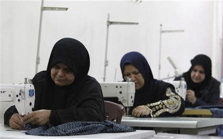 File photo shows widows working on sewing machines at a widows' training and development centre in Baghdad