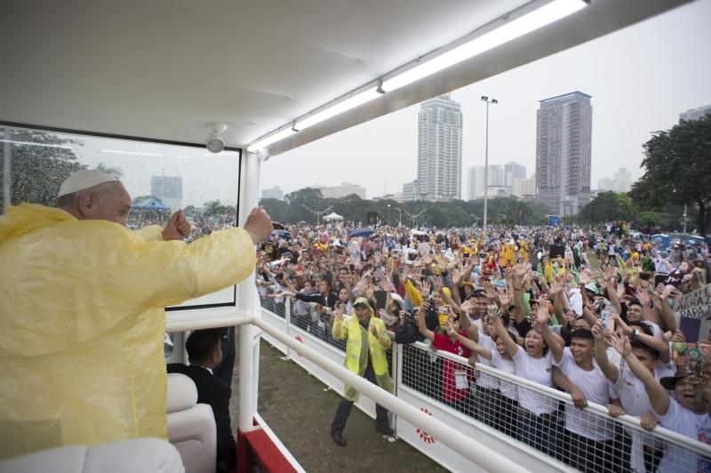 Pope Francis waves from the popemobile after leading a Mass at Rizal Park in Manila