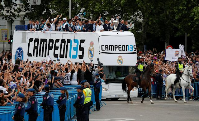 Soccer Football - Real Madrid celebrate winning the Champions League Final - Madrid, Spain - May 27, 2018 Real Madrid players celebrate on the bus with fans during victory celebrations REUTERS/Paul Hanna