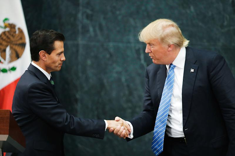 U.S. Republican presidential nominee Donald Trump and Mexico's President Enrique Pena Nieto shake hands at a press conference at the Los Pinos residence in Mexico City, Mexico, August 31, 2016.