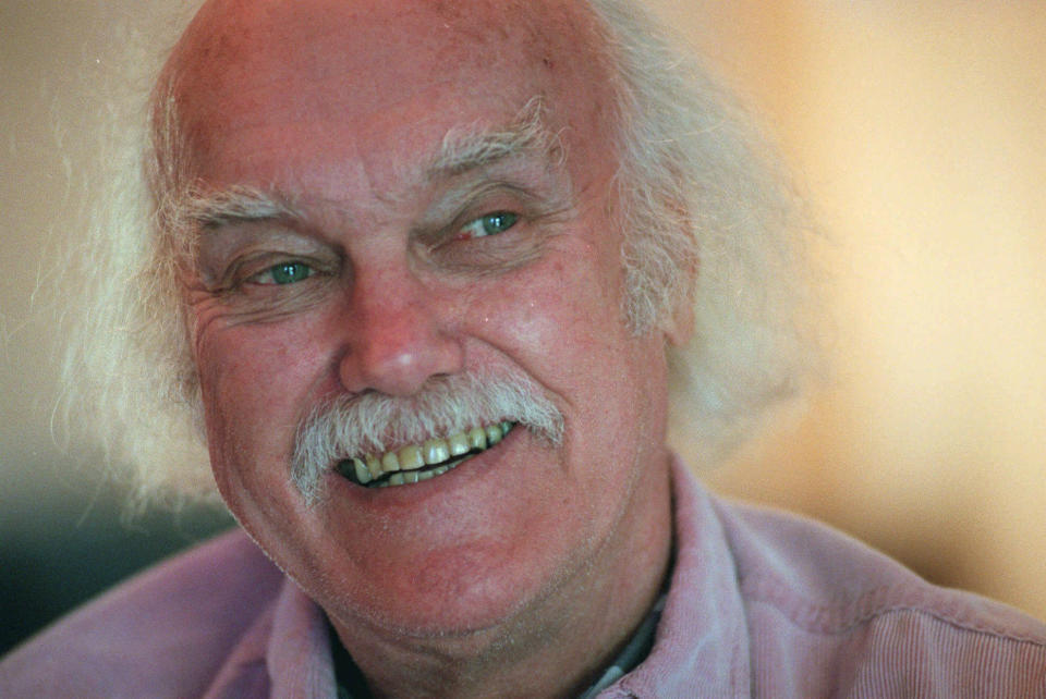 "FILE - In this Oct. 21, 1998 file photo, Ram Dass, best known for the 1971 bestseller ""Be Here Now,"" smiles during an interview at his San Anselmo, Calif., home. The 1960s counterculture spiritual leader and early LSD proponent died, Sunday, Dec. 22, 2019 at his home in Maui, Hawaii. He was 88. (AP Photo/Susan Ragan, File)"