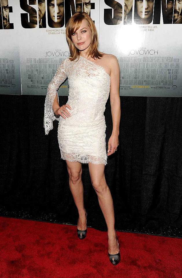 "Also spotted looking lovely in lace ... Milla Jovovich, who attended the star-studded ""Stone"" premiere in a white, one-shoulder Emilio Pucci masterpiece and Sergio Rossi platform peep-toes. Stephen Lovekin/<a href=""http://www.gettyimages.com/"" target=""new"">GettyImages.com</a> - October 5, 2010"