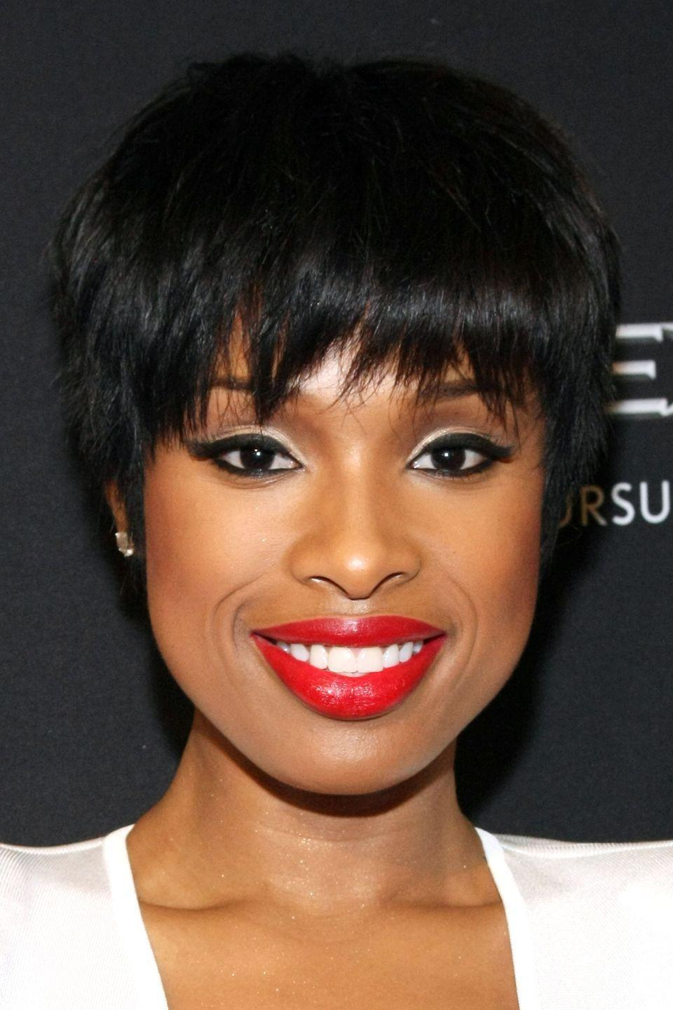 <p>Singer Jennifer Hudson makes her red lips pop with her shaggy bangs and short style. </p>