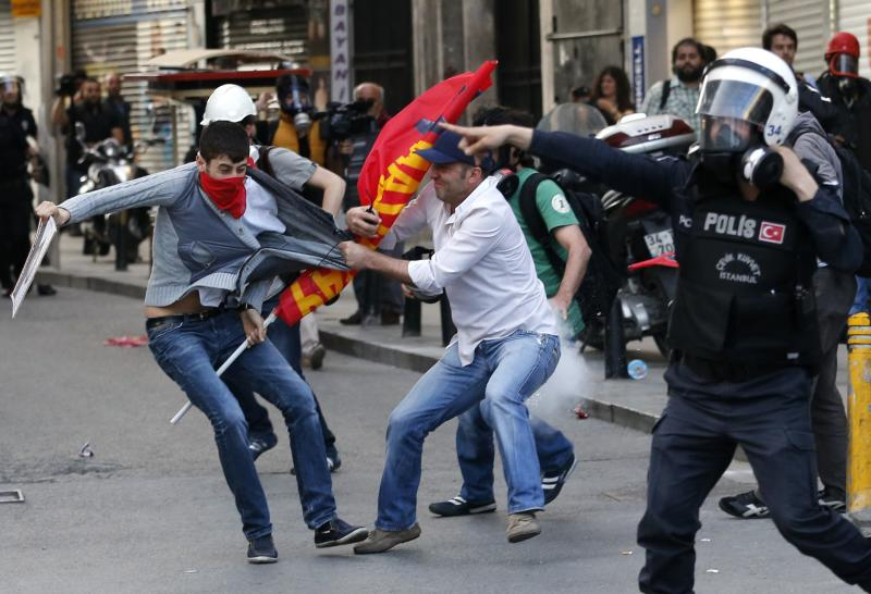 Police detain a protester during a demonstration to blame the government for the mining disaster, in Istanbul