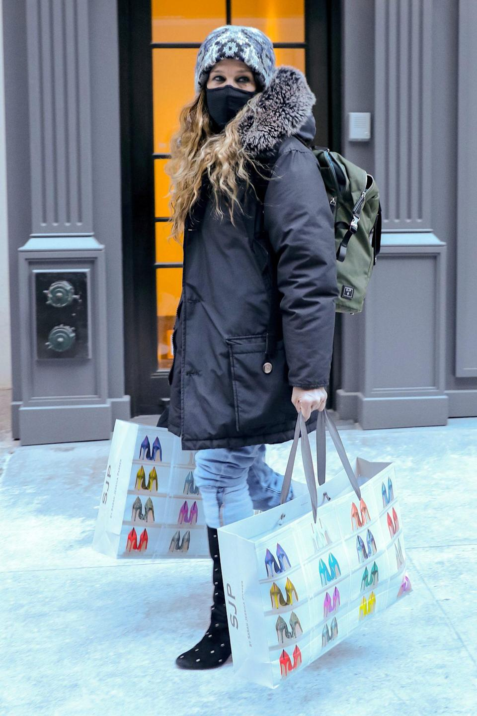 <p>Sarah Jessica Parker has bags full of SJP by Sarah Jessica Parker merch in hand as she leaves her store on Sunday in N.Y.C.</p>