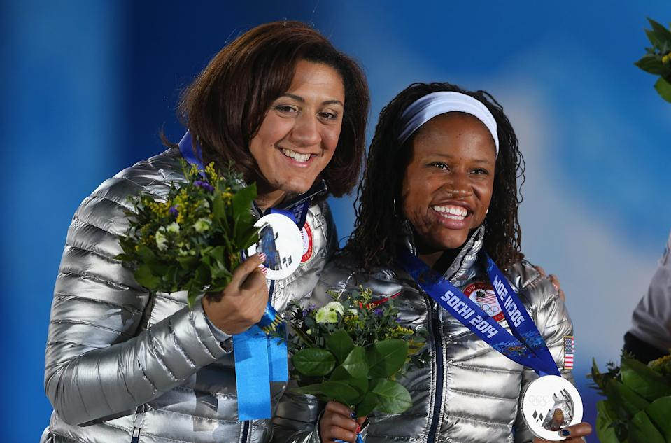 Silver medalists Elana Meyers (L) and Lauryn Williams of the United States team 1 celebrate during the medal ceremony for the Women's Bobsleigh on day thirteen of the Sochi 2014 Winter Olympics at at Medals Plaza on February 20, 2014 in Sochi, Russia.