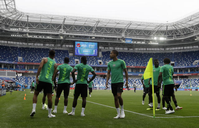 Players warm up during Nigeria's official training on the eve of the group D match between Croatia and Nigeria at the 2018 soccer World Cup in the Kaliningrad Stadium in Kaliningrad, Russia, Friday, June 15, 2018. (AP Photo/Petr David Josek)