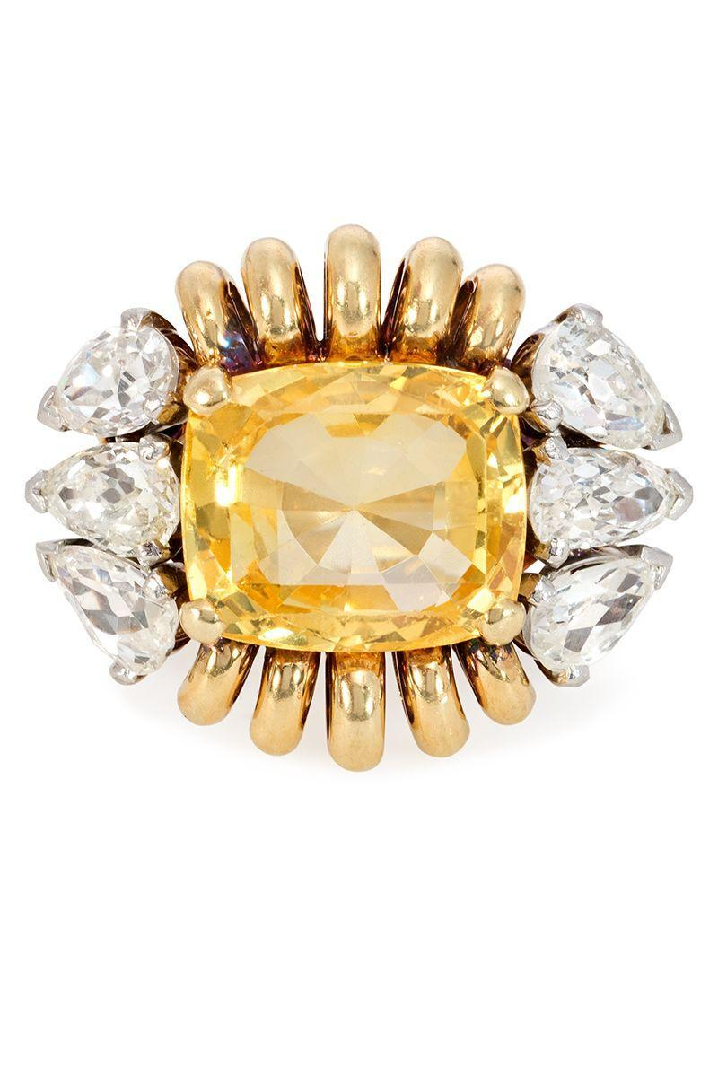 "<p><strong><em>Paul Flato</em></strong><em> Retro Yellow Sapphire and Diamond Ring, circa 1945, $39,000, </em><a href=""https://www.kentshire.com/collections/fine-jewelry/products/retro-yellow-sapphire-and-diamond-ring-flato"" rel=""nofollow noopener"" target=""_blank"" data-ylk=""slk:kentshire.com"" class=""link rapid-noclick-resp""><em>kentshire.com</em></a></p><p><a class=""link rapid-noclick-resp"" href=""https://www.kentshire.com/collections/fine-jewelry/products/retro-yellow-sapphire-and-diamond-ring-flato"" rel=""nofollow noopener"" target=""_blank"" data-ylk=""slk:SHOP"">SHOP</a></p>"