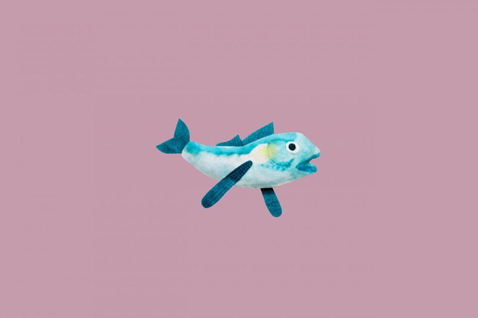 "<p>The only thing better than an adorable dangling cat toy is one with catnip in it, too. This plush fish toy is stuffed with catnip and hangs from a string on rod with a bell to boot.</p> <p><strong><em>Shop Now:</em></strong><em> Cat Person ""Jean-Michel"" Catnip Toy, $7, </em><a href=""https://www.catperson.com/products/catnip-toy"" rel=""nofollow noopener"" target=""_blank"" data-ylk=""slk:catperson.com"" class=""link rapid-noclick-resp""><em>catperson.com</em></a><em>.</em></p>"