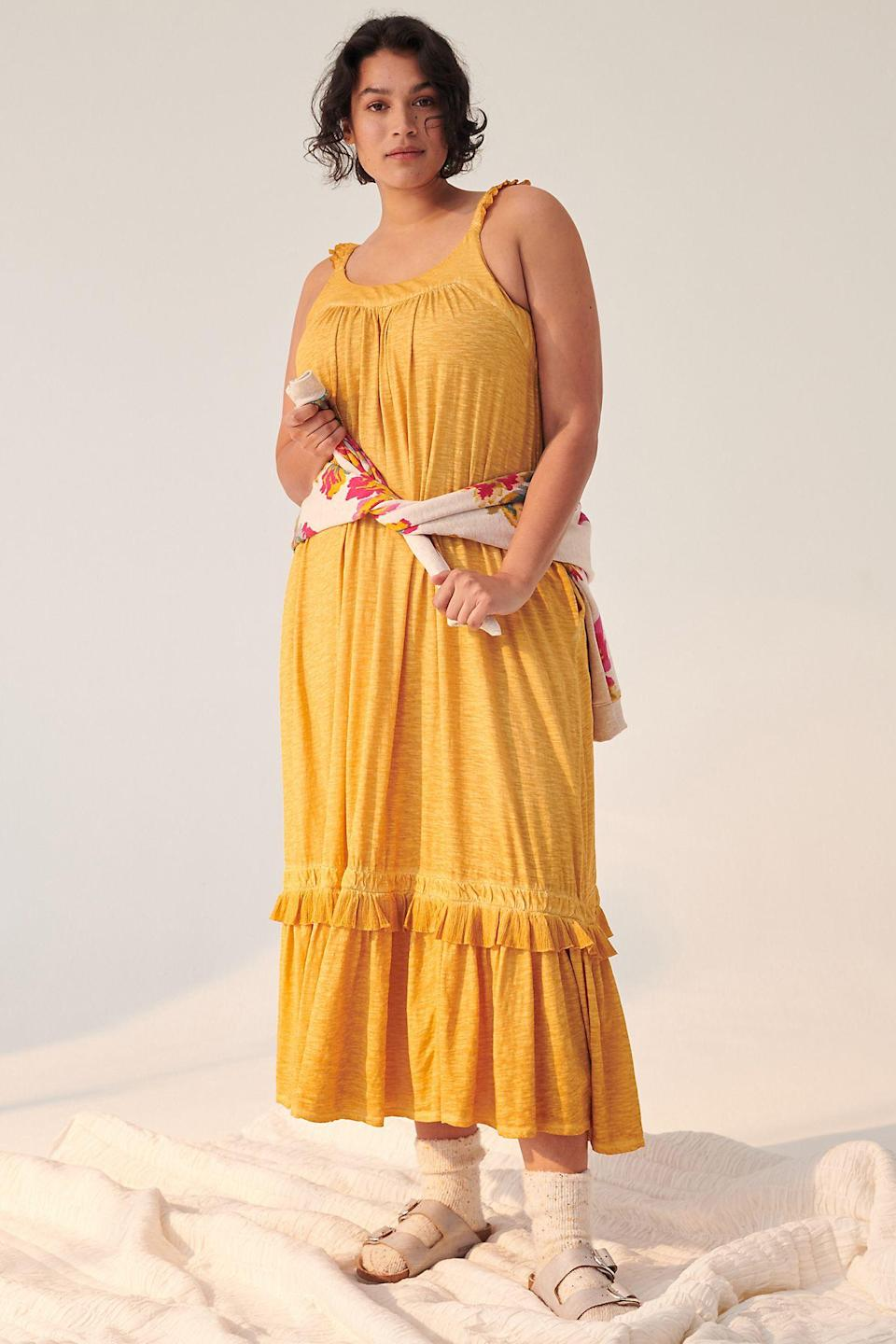"""<h2>Britt Tiered Midi Dress</h2><br><strong>Sizes Available: 1X-2X</strong><br><br><em>Shop <strong><a href=""""https://www.anthropologie.com/shop/britt-tiered-midi-dress?category=plus-size-dresses&color=070&type=PLUS&viewcode=c&quantity=1"""" rel=""""nofollow noopener"""" target=""""_blank"""" data-ylk=""""slk:Anthropologie"""" class=""""link rapid-noclick-resp"""">Anthropologie</a></strong></em><br><br><strong>Saturday/Sunday</strong> Britt Tiered Midi Dress, $, available at <a href=""""https://go.skimresources.com/?id=30283X879131&url=https%3A%2F%2Fwww.anthropologie.com%2Fshop%2Fbritt-tiered-midi-dress"""" rel=""""nofollow noopener"""" target=""""_blank"""" data-ylk=""""slk:Anthropologie"""" class=""""link rapid-noclick-resp"""">Anthropologie</a>"""