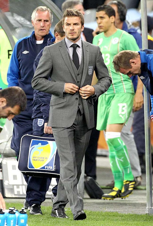 "Speaking of sexy sports stars, David Beckham -- who's been sidelined with an Achilles tendon injury -- has looked exceptionally handsome in his custom-made suits while cheering on his fellow English footballers in South Africa at the World Cup. Juan Soliz/<a href=""http://www.pacificcoastnews.com/"" target=""new"">PacificCoastNews.com</a> - June 18, 2010"