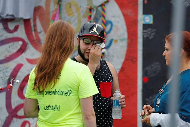 <p>Jose Ramirez, a survivor of the Pulse nightclub shooting, wipes a tear at the memorial outside the club on the one year anniversary of the shooting, in Orlando, Florida, U.S., June 12, 2017. (REUTERS/Scott Audette) </p>