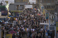 FILE - In this April 7, 2021, file photo, people gather on the Santa Monica Pier in Santa Monica, Calif. Los Angeles County is expected to move Tuesday, May 4 into the least-restrictive yellow tier this week, amid the coronavirus pandemic. (AP Photo/Jae C. Hong)