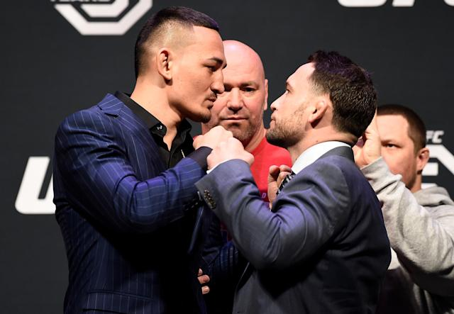 Featherweight champion Max Holloway (L) will defend his title against ex-lightweight champion Frankie Edgar on March 3 at UFC 222 at T-Mobile Arena in Las Vegas. Edgar is looking to become only the fifth UFC fighter to hold a title in two weight classes. (Getty Images)