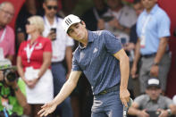 Joaquin Niemann of Chile reacts after missing a putt on the 18th green during the final round of the Rocket Mortgage Classic golf tournament, Sunday, July 4, 2021, at the Detroit Golf Club in Detroit. (AP Photo/Carlos Osorio)