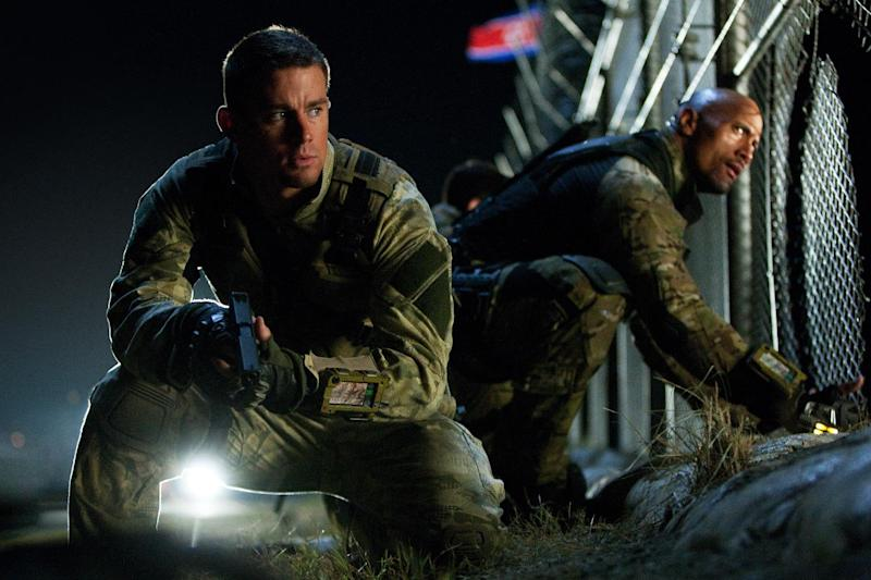 """This publicity photo released by Paramount Pictures shows Channing Tatum, left, as Duke and Dwayne Johnson as Roadblock in a scene from the film, """"G.I. Joe: Retaliation,"""" from Paramount Pictures, MGM, and Skydance Productions. The movie opens nationwide Thursday, March 28, 2013.  (AP Photo/Paramount Pictures, Jaimie Trueblood)"""