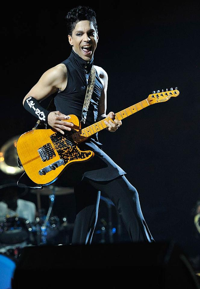 """Prince looked like he was having a good ol' time while kicking off his 21-show concert run at the Forum in Los Angeles on Thursday night. Kevin Mazur/<a href=""""http://www.wireimage.com"""" target=""""new"""">WireImage.com</a> - April 14, 2011"""