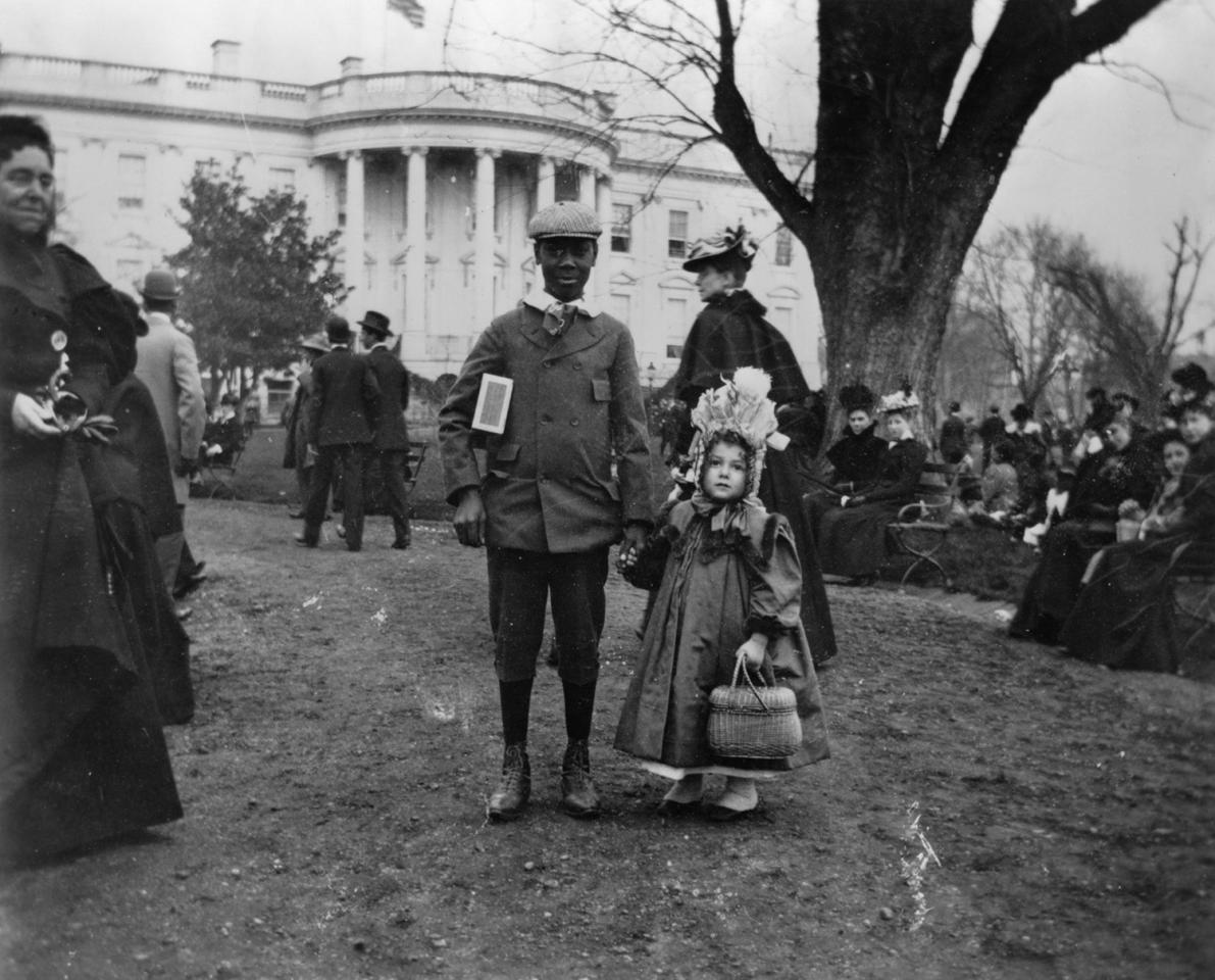 <p>A boy and a girl hold hands during the annual White House Easter Egg Roll, in this photograph taken in 1898 in Washington. (Photo: Francis Benjamin Johnston/Library of Congress) </p>
