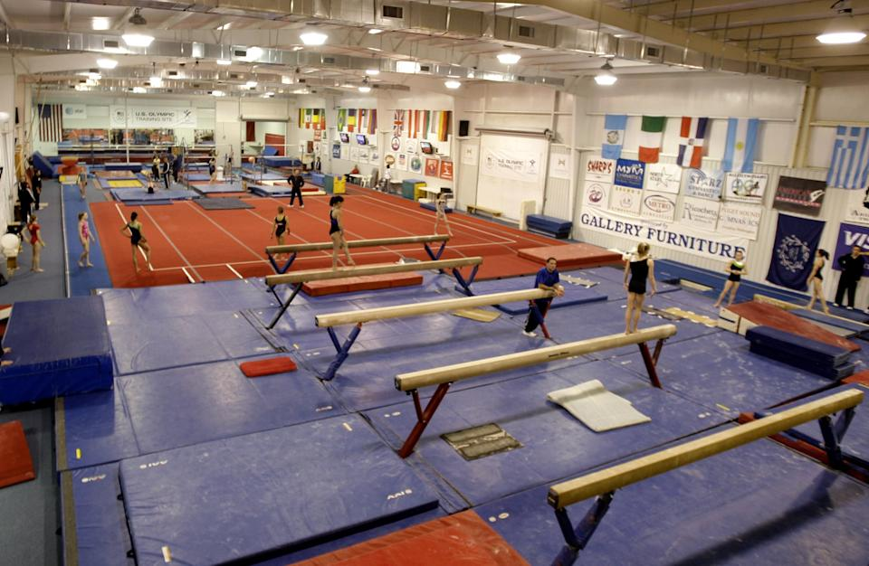 HUNTSVILLE, TX - JANUARY 26: Gymnast workout with their personal coaches during a morning workout session at Karolyi Ranch, which was named an Official USOC Training Site and also Hilton announcing their partership with USOC on January 26, 2011 in Huntsville, Texas. (Photo by Bob Levey/Getty Images for Hilton)