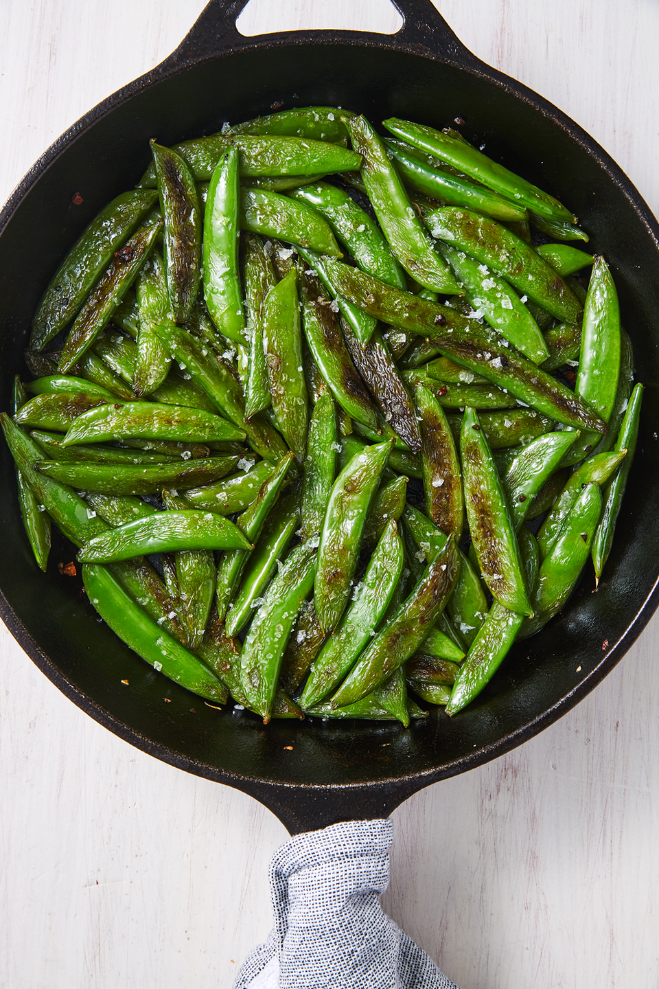 """<p>Sugar snap peas only take 5 minutes to sauté into crispy perfection.</p><p>Get the <a href=""""https://www.delish.com/uk/cooking/recipes/a33363698/sugar-snap-peas-recipe/"""" rel=""""nofollow noopener"""" target=""""_blank"""" data-ylk=""""slk:Sugar Snap Peas"""" class=""""link rapid-noclick-resp"""">Sugar Snap Peas</a> recipe.</p>"""