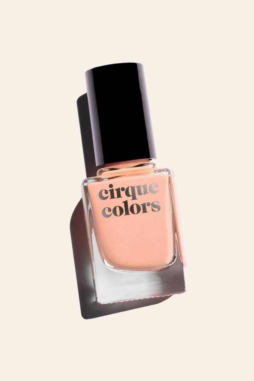 "<h3>Creamy Peach</h3> <br>""This color is basically summer in a bottle,"" says nail pro Skyy Hadley. ""Its beautiful <a href=""https://www.refinery29.com/en-us/peach-nail-polish"" rel=""nofollow noopener"" target=""_blank"" data-ylk=""slk:peach shade"" class=""link rapid-noclick-resp"">peach shade</a> looks amazing on all skin tones."" Plus, because it's a full-coverage creamy formula, it gives your nails a glossy peach-tinted veil in one to two coats.<br><br><strong>Cirque Colors</strong> Met Steps, $, available at <a href=""https://go.skimresources.com/?id=30283X879131&url=https%3A%2F%2Fwww.cirquecolors.com%2Fmet-steps%2F"" rel=""nofollow noopener"" target=""_blank"" data-ylk=""slk:Cirque Colors"" class=""link rapid-noclick-resp"">Cirque Colors</a><br>"
