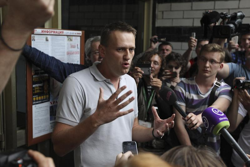 Russian opposition leader Alexei Navalny speak to the media following a police search in his flat in Moscow, Russia, June 11, 2012. Russian investigators searched the apartments of several protest leaders Monday and called them in for questioning Tuesday, making it difficult if not impossible for them to lead a mass demonstration against President Vladimir Putin planned for the June 12 national holiday.(AP Photo/Leonid Lebedev)