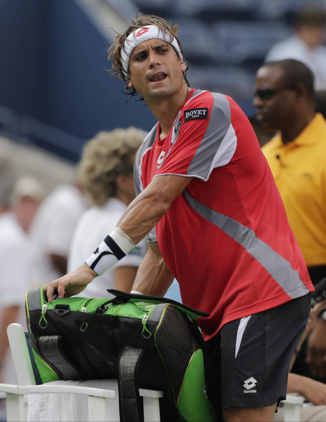 Spain's David Ferrer comments as he packs up his gear after a semifinal match against Novak Djokovic, of Serbia, was postponed because of approaching inclement weather at the 2012 US Open tennis tournament, Saturday, Sept. 8, 2012, in New York. (AP Photo/Charles Krupa)