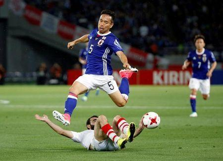 FILE PHOTO: Soccer Football - Japan v Syria - International Friendly - Tokyo Stadium, Tokyo, Japan- 07/06/17 - Japan's Yuto Nagatomo and Syria's Amro Jeniat in action. REUTERS/Toru Hanai/File Photo