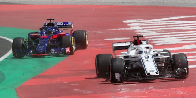 Formula One F1 - Spanish Grand Prix - Circuit de Barcelona-Catalunya, Barcelona, Spain - May 13, 2018 Sauber's Marcus Ericsson and Toro Rosso's Brendon Hartley leave the track during the race REUTERS/Albert Gea