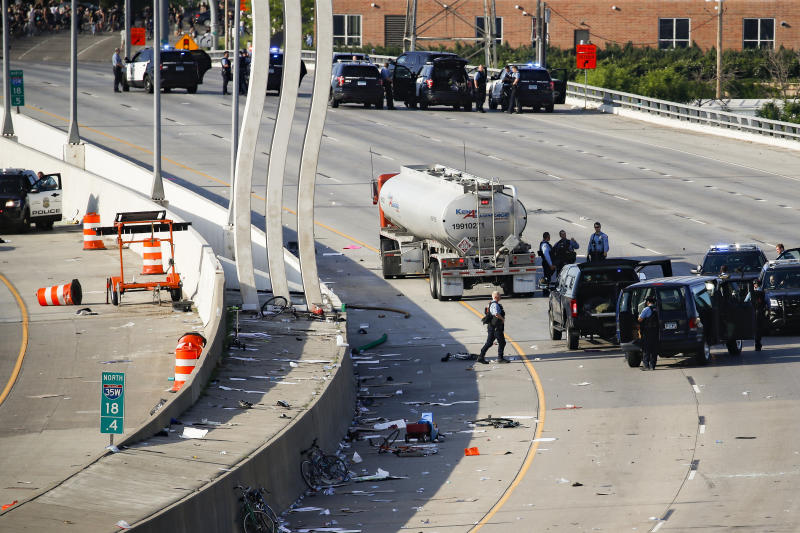 A semi-truck involved in an incident with protesters on Highway 35W is surrounded by authorities, Sunday, May 31, 2020, in St. Paul, Minn. Protests continued following the death of George Floyd, who died after being restrained by Minneapolis police officers on Memorial Day. (AP Photo/John Minchillo)