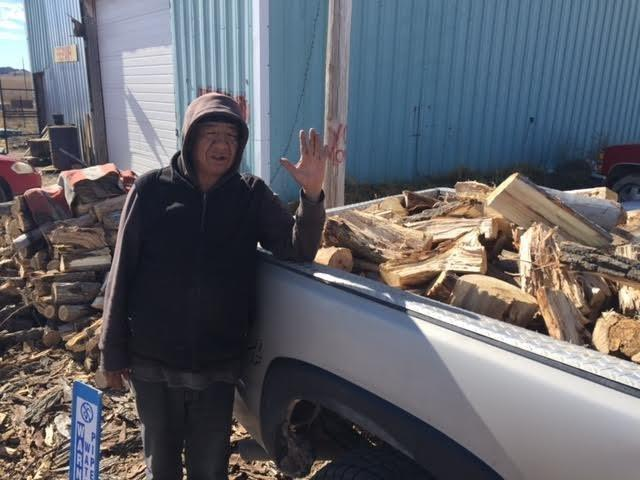 The nonprofit One Spirit hires five local residents to cut wood and deliver it to people in need on the reservation. The employees earn $100 to $150 per delivery. (Jeri Baker/One Spirit)