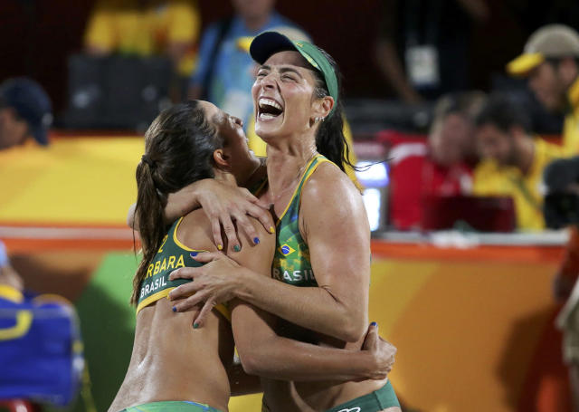 <p>Barbara Seixas Figueiredo and Agatha Bednarczuk of Brazil celebrate after winning a semifinal against the USA in women's volleyball. (REUTERS/Adrees Latif) </p>