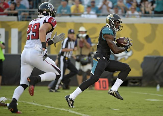 Jacksonville Jaguars wide receiver Marqise Lee (11) outruns Atlanta Falcons defensive back Sean Baker (29) to the end zone to score a touchdown on a 57-yard pass reception during the first half of an NFL preseason football game in Jacksonville, Fla., Thursday, Aug. 28, 2014. (AP Photo/Phelan M. Ebenhack)
